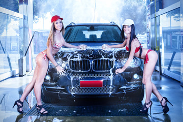 Two sexy girls in car wash