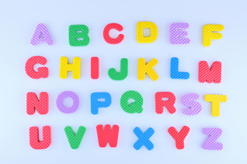 Colorful English alphabet isolated on a light blue background
