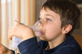 child with electric nebulizer poster