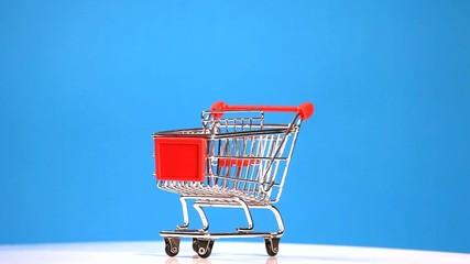 shopping cart isolated on blue background