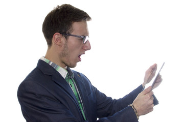 Outraged young handsome man holding a tablet or ipad