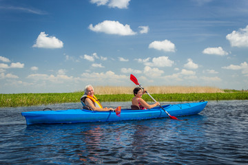 Couple kayaking on river
