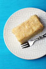 Napoleon cake on plate on table close-up