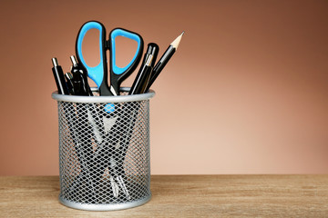 Metal holder with pens, pencil and scissor