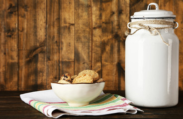 Milk can with bowl of cookies