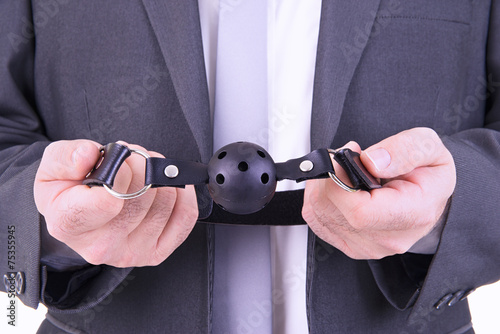 Poster Businessman holding ball gag