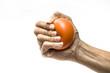 Leinwandbild Motiv Hands of a woman squeezing a stress ball