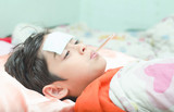 Fototapety Little sick boy with temperature in mouth