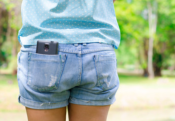 Mobile in short pocket at park