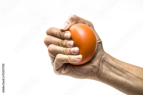 Hands of a woman squeezing a stress ball - 75357700