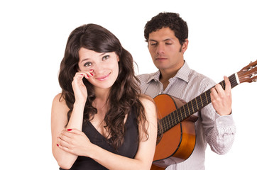 handsome young man with guitar serenading beautiful girl