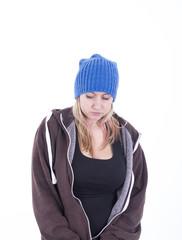 Serious blonde girl wearing blue bonnet