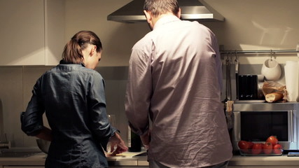 Young couple cooking in kitchen at home at home