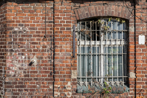 Forgotten building with bars on the window - 75359942