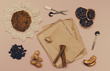 Collage of vintage paper, cinnamon and coffee