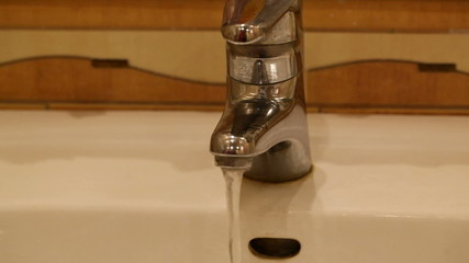 Water flows from the tap washbasin
