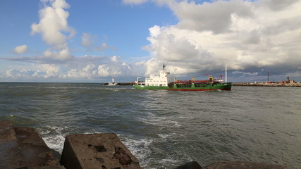 ship going into Baltic Sea wave Ventspils harbour Latvia video