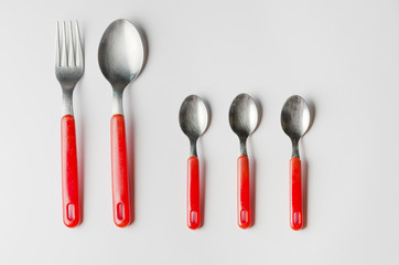 family of fork, spoon and three teaspoons