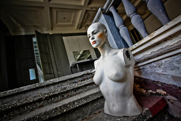 Beautiful mannequin in abandoned store