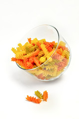 Colorful pasta in a glass  on white background