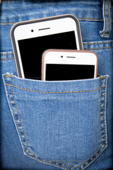 Cell phones in back pocket of girl's jeans