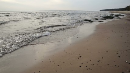 waves crushing on the beach sand