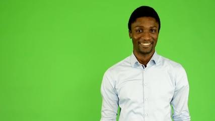 young handsome black man smiles - green screen-studio