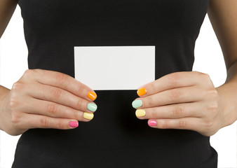 young girl with bright manicure keeps business card