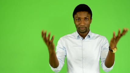 young handsome black man do not understand - green screen