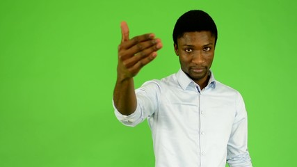 young handsome black man invites - green screen