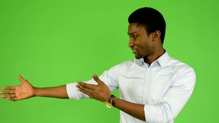 young handsome black man introduce - green screen