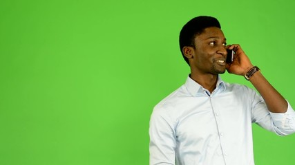 young handsome black man phone - green screen