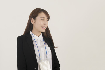 Beautiful young asian businesswoman with id card