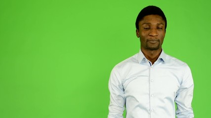 young handsome black man disagrees - green screen