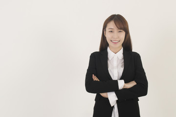 Attractive asian businesswoman with her arms crossed