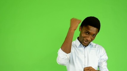 young handsome black man rejoices - green screen - studio