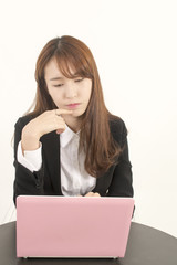 Stressed asian businesswoman with laptop