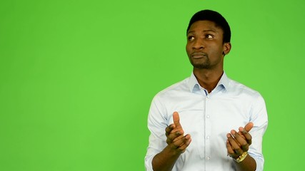 young handsome black man is surprised - green screen