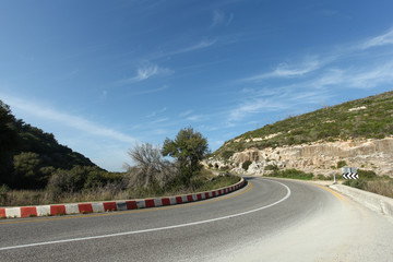 Curved road with blue sky