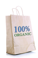 Paper bag with organic products isolated on white