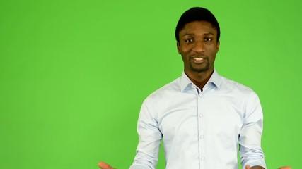 young handsome black man talk - green screen