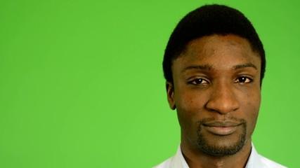 black man winks the eye- green screen- closeup