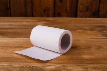 Toilet paper on a wooden table