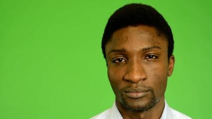 unhappy black man look to camera - green screen- closeup