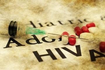 Syringe on aids text