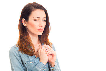 woman touching her ring thinking marriage problems isolated