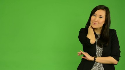 young attractive asian woman seduces - green screen