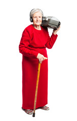 Senior woman listening to music while carrying stereo recorder