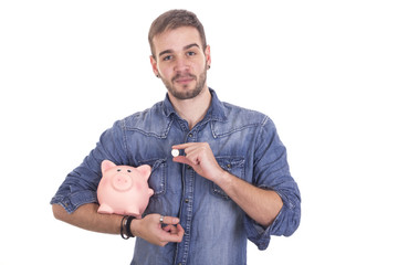 Handsome guy holding piggy bank and coin