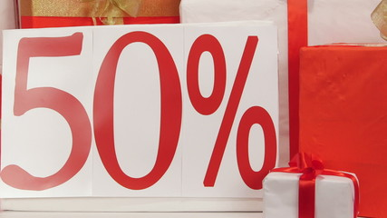 Dolly: Red white gift boxes with fifty percent sale discount